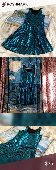 Aqua Mermaid Skater Dress Adorable mermaid scale print spandex mini dress. Super shimmery and irredescent. Medium, fits more like a small. Also available in green.   Additional keywords: light bright electric sky blue shiny sparkly sparkle ocean beach sea mythical fish scales formfitting form fitting slim fun quirky club clubbing sexy tankdress tank sleeveless Dresses Mini