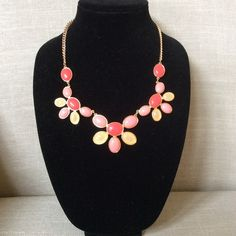 Statement NecklaceDRASTIC PRICE DROP‼️ This coral, peach and pale  yellow  necklace will make a statement while wearing it. This pretty necklace was purchased from a local boutique. Perfect for summer! Jewelry Necklaces