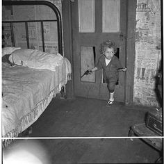 """Why open the door, coal miner's child uses the """"cat hole."""" Bertha Hill, West Virginia (Note pipe in one hand, gun in other).  Wolcott, Marion Post,  photographer. Created/Published: 1938 Sept. Old Pictures, Vintage Pictures, Vintage Images, Old Photos, Vintage Photographs, Coal Miners, Interesting History, American History, Appalachian Mountains"""
