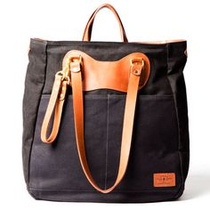 """The RucTote in black canvas with tan leather trim.7"""") height x 15cm (6"""") width x 40cm (16"""") length.] $590 USD"""