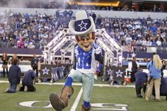 Rowdy runs onto the field during a home game at AT&T Stadium
