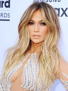 Theres a new photo trend out to replace the duck-face pose: the fish gape. (Jennifer Lopez, pictured above) | allure.com