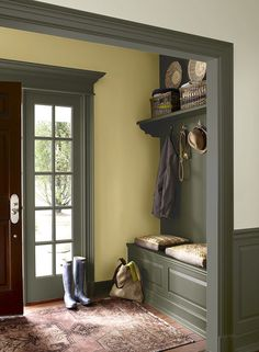 The trim color is Gloucester Sage by Benjamin Moore and white wall color in the hallway is Chatsworth Cream.