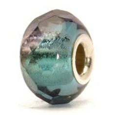 Turquoise Prism - The purple sheen of the glass suits this turquoise bead well. The two colors both complement and challenge each other; darkness and light, feminine and masculine.