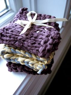 Recycle t-shirts into knitted dishcloths. Links to making tarn, as well as options for crochet or knit styles.
