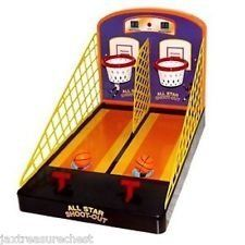 Electronic Basketball Game : All Star Shoot Out. Electronic basketball game with lights and cheering when ball goes into basket.  Whistle sound and counter sounds. Keeps score.