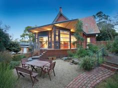 Brick edwardian house exterior with balcony & landscaped garden - House Facade photo 525905