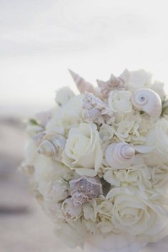 This pretty seashell bouquet is the perfect accompaniment to a beach wedding.