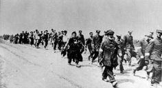 Poland, Jews on their way to forced labor.