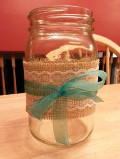 My mason jar centrepiece.  Will be on a burlap table square with teal weaving, wood slab, mason jar, then yellow roses with baby's breath.