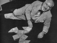 Bucky on the floor with what appears to be his 1944 version of the Dymaxion Map, and its origami look.