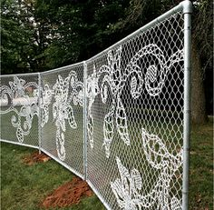 from the book YARNBOMBING...yarn woven into a fence to create a lace pattern