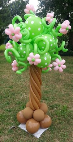 Balloon Column Ideas: Balloon tree with green and white polka dot balloons and pink flowers. Pretty.