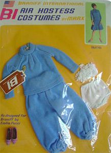 """Braniff ensemble, the Blue """"Hostess Pajamas""""  Braniff was an airline based in Texas.  They had colorful airplanes and their stewardesses wore outfits designed by Emilio Pucci.  Montgomery Ward sold these replicas in 1967.  They were not made by Mattel, they were made in Hong Kong.  The clothes are tagged & the shoes are marked Hong Kong."""