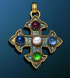 An early 20th century gem-set cross pendant  The fleureé cross with blue enamel ground and central bouton pearl, set to the cardinal points with an emerald, ruby, sapphire and pale blue paste, with beaded border and carved foliate reverse, suspended from an associated impressed triple-link chain, length of pendant 4.5cm., length of chain 60.0cm.