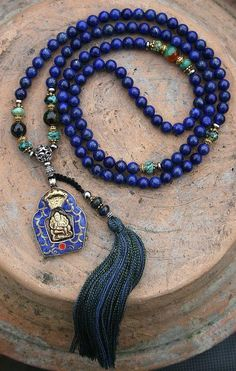 Beautiful Mala necklace made from 108 Lapis Lazuli gemstones with a diameter of 8 mm - inch. The Mala is decorated with African Turquoise, faceted Agate, Hematite, copper color and metal color beads and a Nepalese Ganesha (Ganesh) pendant - Made by Bohemian Jewelry, Beaded Jewelry, Jewelry Necklaces, Bijoux Lapis Lazuli, Gemstone Necklace, Beaded Necklace, Ganesh Pendant, Yoga Jewelry, Copper Color