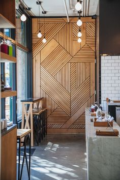 Wall covered with a timber marquetry to create a warm panel in the restaurant