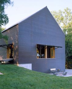 Interesting Images Of Cool Barn House Design And Decoration Ideas: Endearing Image Of Cool Barn House Exterior Design And Decoration Using Dark Grey Home Exterior Wall Color Scheme And Natural Oak Wood Pallet Garden Bench And Outdoor Black Iron Metal Chairs ~ motcavs.com Interior Inspiration