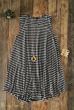 """Easy-fit striped jersey flare tunic. A-line style. Looks great alone or over a pair of our B123 White Jeggings or Capri Leggings. 95% Rayon 5% Spandex. Small - 32.5"""" from shoulder to hem Medium - 33"""""""