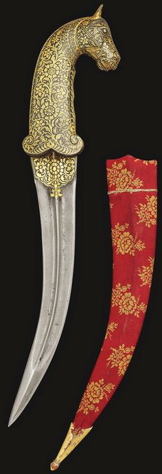 Indian jambiya dagger, 19th century, curved double edged steel (jawhar) blade with central ridge, decorated at the forte with a medallion of gold overlay floral motifs, hilt with gold koftgari work of scrolling leafy tendrils issuing flowers, pommel in the form of a horse's head, with a cloth-covered wooden scabbard with a gilt copper chape, 38.3cm.