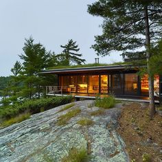 Canadian firm Ian MacDonald Architect has completed a family retreat in southern Ontario that cantilevers over a rocky hillside and is designed to be mostly hidden from view. See a full set of images on dezeen.com/architecture #architecture #Canada #Ontario Photography is courtesy of Ian MacDonald Architect.