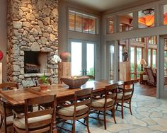 Interior, Outstanding Solid Wood Coloumns With Stone Surround Fireplace Wooden Dining Table With Wooden Chairs Stone Tiles Floor: Awesome Interior Decorating Use Solid Wood Columns Designs
