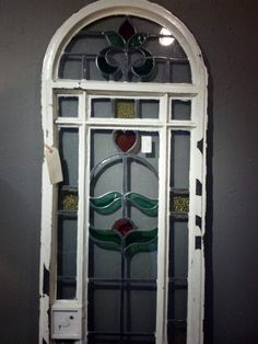 Cast iron door with stained glass,one of a pair