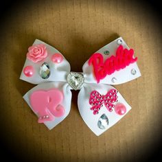 Barbie Pink and White Rhinestone Hair Bow. White Grosgrain Ribbon Decorated With Barbie Accents, Stones and Beads. Mounted on an Alligator Clip. I can do custom bows, please dont hesitate to contact me if youd like something Specific.