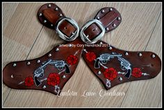 Custom painted spur straps, pistols, roses and barbed wire