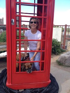 A Viking's fan and her dog in the red phone booth! | #VikingsInUK