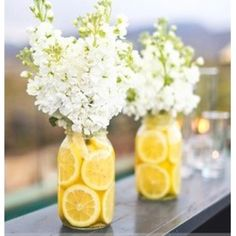 Flowers with lemons in mason jars, so fresh yet elegant :)