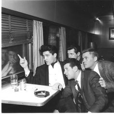 "Wednesday, April 20, 1960: Elvis, Charlie Hodge (obscured), Joe Esposito and Delbert ""Sonny"" West are pictured aboard a train heading to Hollywood to film his first post-Army movie ""G.I. Blues"". On Monday, April 18, 1960 EP and his pals had boarded their Hollywood-bound train at Memphis Central Station. Take a look inside the FTD book ""Elvis Presley From Memphis To Hollywood"": https://www.youtube.com/watch?v=PPFEND8Ovmo"