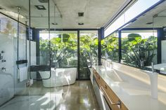 Image 9 of 37 from gallery of BT House / Estudio Jorgelina Tortorici Arq. Photograph by Alejandro Peral Casa Art Deco, Metal Shutters, Raised House, Casa Patio, Concrete Structure, Ground Floor Plan, Home Upgrades, Architect House, Tropical Houses