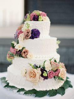 wedding cake with purple flowers - photo by Kylie Martin Photography http://ruffledblog.com/lavender-big-island-wedding #weddingcake #cakes