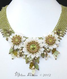 Waterlilies necklace by Cielo Design, via Flickr.  Loving the embellishment