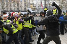 Riot police beat back the gilets jaunes protesters close to the Arc de Triomphe Ukraine, Riot Police, Immigration Policy, The Guardian, Pictures, Photos, Gilets, Danger, Moscow