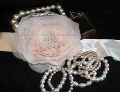 Pale pink chiffon rose bridal sash on a 50 mm double satin cream ribbon
