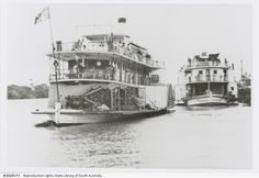 The 'Gem' and 'Marion' moored side by side at Murray Bridge. Reproduced as a postcard, the caption on the back reads 'Friendly competitors. By the 1930s the few remaining river boats catered mainly for the tourist trade, cruising  between such places as Renmark and Goolwa; calling at towns along the way. Sometimes friendly rivalry between Captains would result in a race with each crew trying to outdo the other
