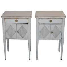 Sweden. White painted wood nightstands, doors with reeded lozenges below single box drawers (set of 2). ca1880. h27w17d12