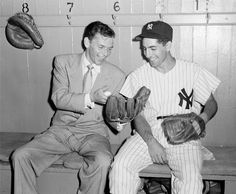 """Frank Sinatra shares a laugh with Phil Rizzuto in the dugout at Yankee Stadium in 1949.  Sinatra was preparing for a role as a baseball player in the upcoming film """"Take Me Out To The Ballgame."""""""