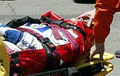 (dpa files) - Paramedics and members of the safety team attend to German formula one pilot Ralf Schumacher of BMW - Stock Photo