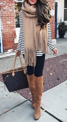 Gigantic Frindge Scarf + Knee Length Boots + Skinny Jeans + Striped Sweater                                                                             Source