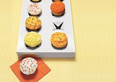 cut crosses into a box lid for a cupcake holder