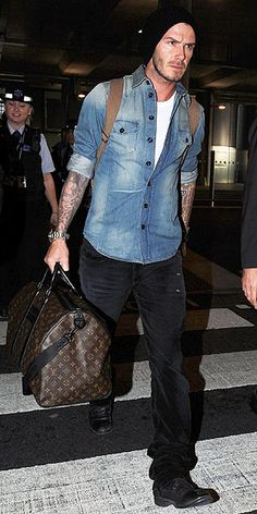 Becks wearing denim on denim with the classic LV Waterproof Keepall.