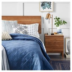 Create your own at-home getaway with a peaceful palette, super soft bedding and beautiful walnut mid-century furniture.