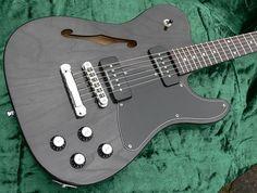 Fender Telecaster Thinline JA-90 Jim Adkins signature guitarwith Seymour Duncan P-90s, Adjusto-matic bridge and transparent black finish.
