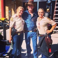 Goddess and another on the set of What guy in the world wouldn't want to trade places with Sheriff Longmire here, who doesn't have a jealous wife or girlfriend? Longmire Series, Walt Longmire, Katee Sackhoff Longmire, Vic Moretti, Robert Taylor Longmire, Craig Johnson, Funny Commercials, Great Tv Shows, Book Tv
