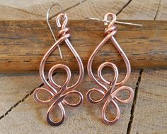 Celtic knot designs inspired these long hammered copper earrings. The ear wires in the pictures are sterling silver. You can also choose surgical steel or copper earwires. These earrings in the pictures are made with 14 gauge copper wire. We can make them smaller and lighter in 16