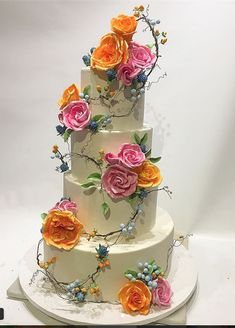 sStunning floral and branches wedding cake with thistles; berries...