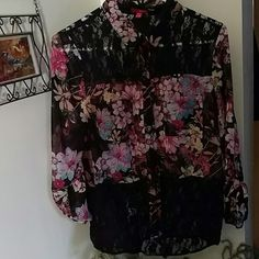Adorable Top !! Has floral design Lace on top and bottom of shirt 2 small pockets on upper body Button down Sleeves have buttons ... Adjustable to shorten or lengthen the sleeves BONGO Tops Blouses